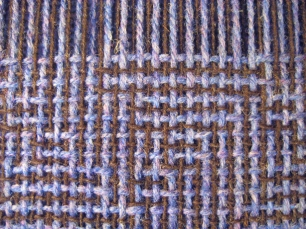 Shadow weave in woolen yarns - close-up of weaving in progress on the loom before wet finishing